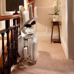 brooks curved stairlift folded at top of stairs