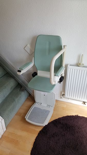 bison bede compact straight stairlift at the bottom of the stairs