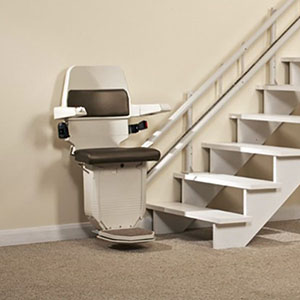 reconditioned stannah curved stairlift parked in hallway