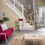 Otolift one new curved stairlift folded up at bottom of stairs