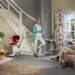 Otolift one new curved stairlift at bottom of stairs