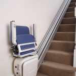Liftable cumbria straight stairlift folded away